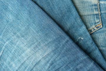 Blue jeans pile. Denim Texture.