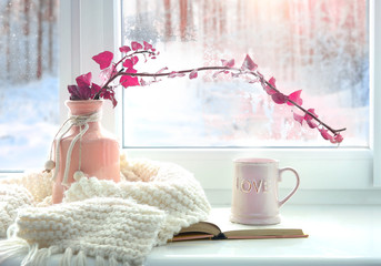Winter home romantic icon.Valentine card.Mug with knits and book on window sill.