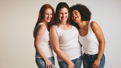 Diverse group of women laughing together