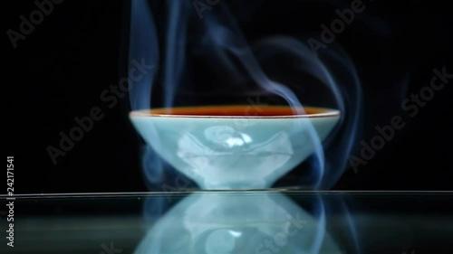 Chinese black tea cup smoke dark background nobody hd footage