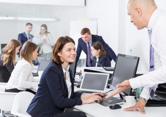 female talking to male colleague