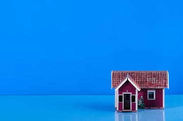 Small house miniature business on blue background
