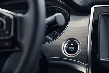 Engine Start Stop button of a modern car. The interior of the expensive car