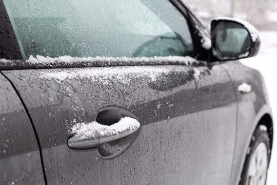 car handle in snow gray winter ice white frost frost frost