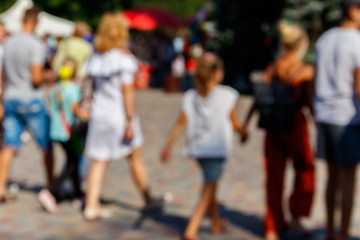 Blurred defocused abstract background of people walking on the city street. Unrecognizable faces