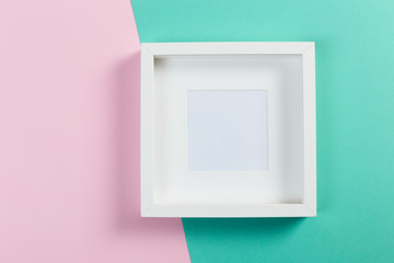 white frame on pink and menthol background