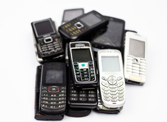 bunch of old cell phones mobile communication retro broken white button tube