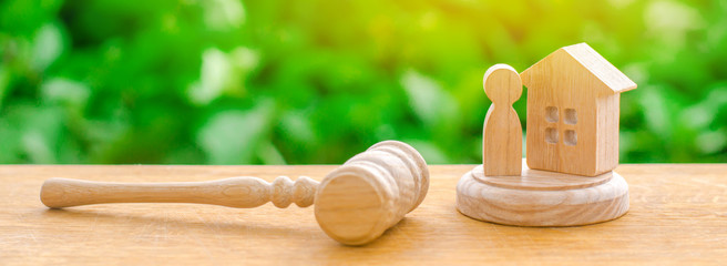 The judges hammer and the wooden and human figure. Concept of justice and litigation. The decision of the fate of the defendant and property. Protection of rights and confiscation of property