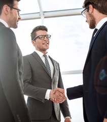 close up.young businessman shaking hands with investor
