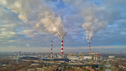 Obraz komin dym miasto niebo - fototapety do salonu