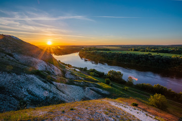 Beautiful sunrise above river Don and chalky hills, Voronezh region