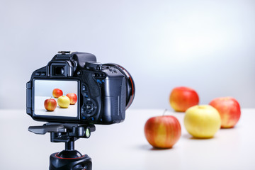 photographing food indoors. taking photo of apples