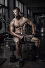 Tired fitness guy sitting