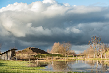 flooded landscape with hat in front of gray sky in Germany Bavaria