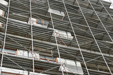 new building under construction, scaffolding and concrete