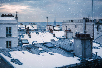 Rooftops and snow in Paris, France