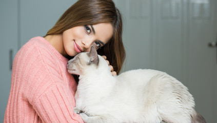 Gorgeous brunette loving her cat.