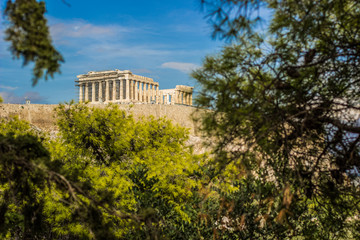 Acropolis world famous heritage touristic site object antique building from ancient Greece times landmark photography in park outdoor nature plant branches frame