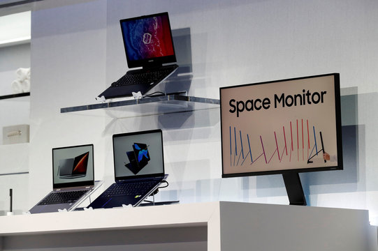 New laptop computers and a space-saving Space Monitor are displayed during a Samsung news conference at the 2019 CES in Las Vegas