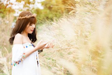 Asian beautiful woman wearing bohemian clothes Standing smiling happily in morning natural tourism in the grasslands during summer holiday Makes you feel relaxed and refreshed your mind and body again