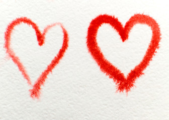 two red hearts drawn with watercolor on watercolor paper. symbol of love and romance.