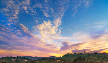 Sunset landscape, blue, purple, gold sky with clouds, wine country California, Napa valley scenery Wall mural