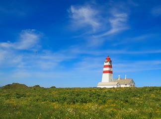 Alnes lighthouse at clear sky at Godoy island near Alesund,