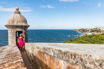 Puerto Rico San Juan city travel tourist taking phone selfie photo at Castillo San Felipe Del Morro fortress. Tourism in Old San Juan main attraction of the city famous cruise destination.