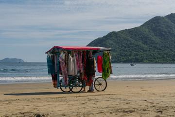 Wall Murals Caribbean La tienda de ropa ambulante en el paisaje de la playa de Manzanillo Colima.