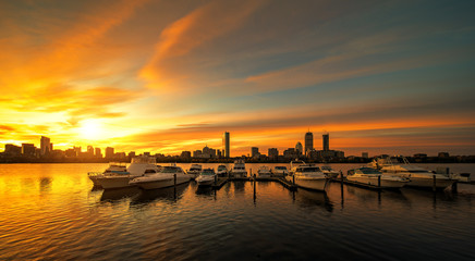 Wall Mural - Sunrise over Boston city with boat and harbor