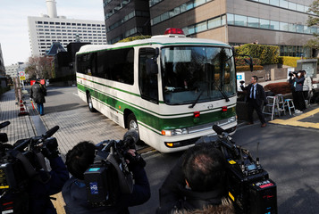A bus believed to be carrying the ousted Nissan Motor Co Ltd chairman Carlos Ghosn, leaves the Tokyo District Court in Tokyo