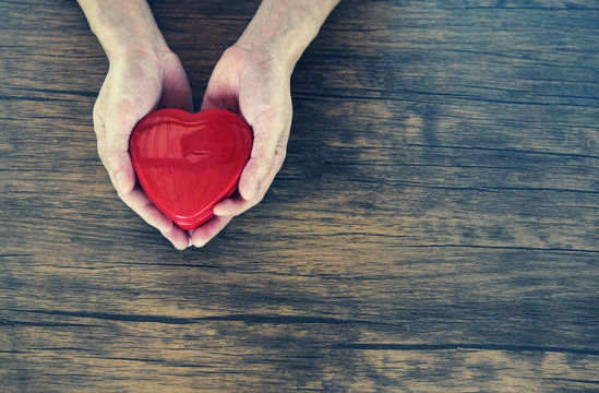 Give Love Man holding red Heart in hands for love Valentines day Donate  Help Give love warmth take care concept
