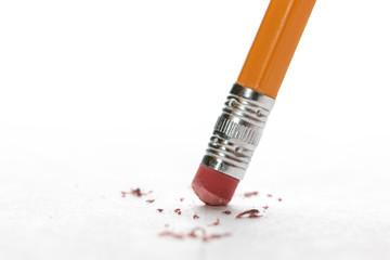 Pencil erasing mistake made on white paper