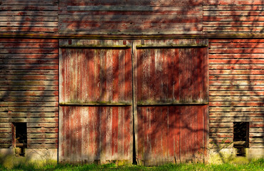 Old rustic red barn in the Illinois woods.