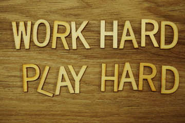 Work Hard Play Hard alphabet letters on wooden background business concept