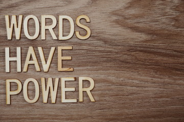 Words Have Power alphabet letters on wooden background business concept