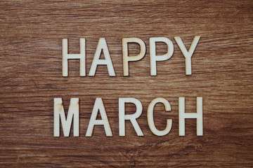 Happy March text message on wooden background
