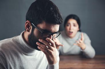 angry woman with sad man