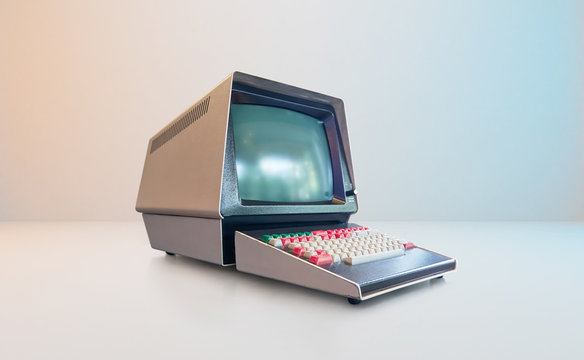 Old vintage and style computer on white wall background .