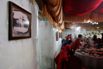 """Customers eat hotpots at Shangri-La Hotel's """"Ice Palace"""" restaurant and bar in Harbin"""
