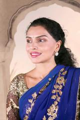 Beautiful Indian woman looks pensive