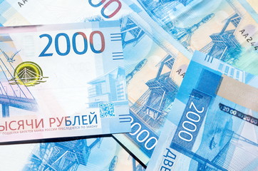 New russian banknotes of 2000 rubles close-up, background