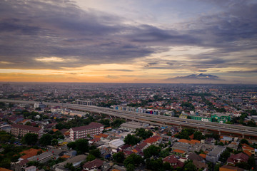 Becakayu tollway with dense housing at sunset