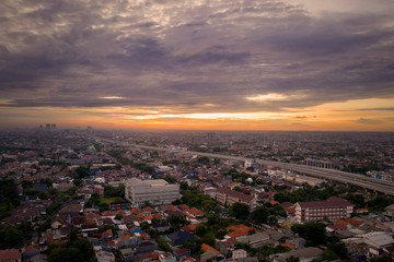 Crowded residential near Becakayu tollway at sunset