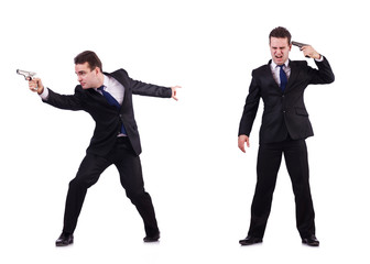 Man in suit with gun isolated on white