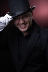 Photo of happy man in black hat in white gloves