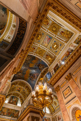SAINT PETERSBURG, RUSSIA - January 2, 2019: Beautiful interior of the St Isaac's Cathedral. Luxurious ceiling and dome inside the famous cathedral.
