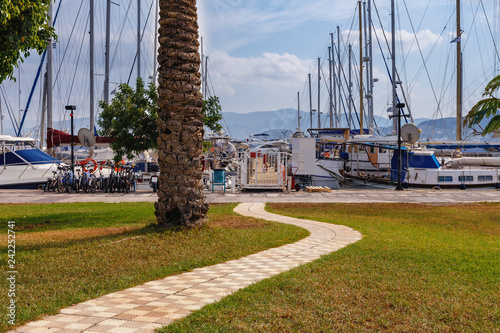 Stone Paved Walkway To The Marina In The Greek Town Of Agios
