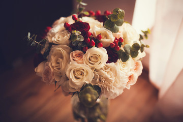 wedding bouquet with rose bush on table