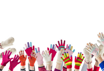 children hands with winter gloves and mittens isolated